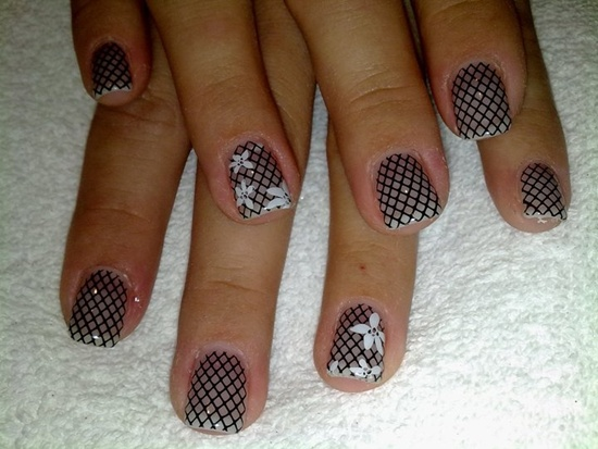 another great example of patterns looking fabulous in as gel nail art here the wearer has added a few flowers to just a few nails to add some intriguing - Gel Nail Design Ideas