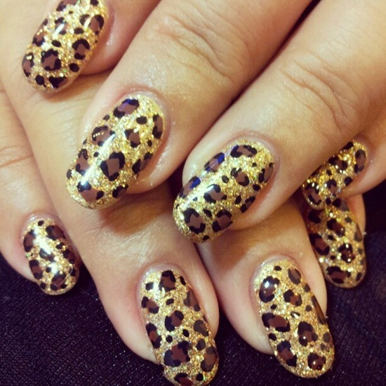 20 glitter nail designs for the everyday glamazon leopard print adds instant sex appeal to anything upon which it is painted but the gold glitter base of this particular design makes it just as glamorous prinsesfo Images