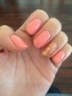 20 glitter nail designs for the everyday glamazon those with a more subdued classic style can still integrate some shimmer into their lives simply paint your other nails with a feminine shade like coral prinsesfo Image collections