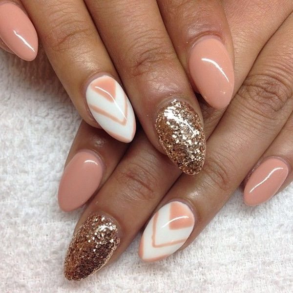 Using the triable shape really accentuates the almond shape. You can see  that the artist got really creative here, but the design is pleasurably  simple. - 30 Must Try Almond Nail Designs