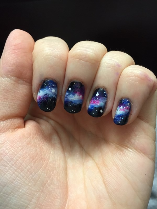It looks as if one galaxy spreads across all four fingers – a mural of nail  art. - 48 Stunning Galaxy Nail Designs + Video Tutorial!