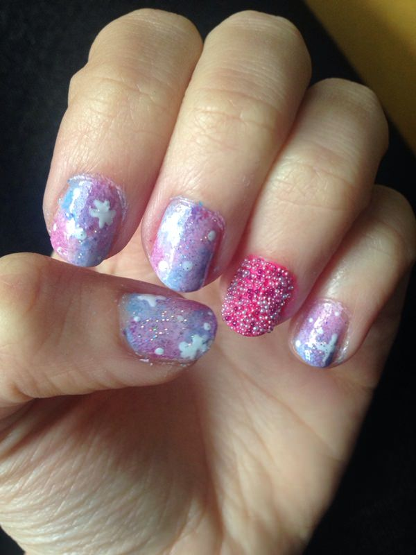 Galaxy nail art goes wonderful with beaded and bubbled accented nails. The  combination of pastels give a soft, luminous look to these miniature  galaxies and ... - 48 Stunning Galaxy Nail Designs + Video Tutorial!