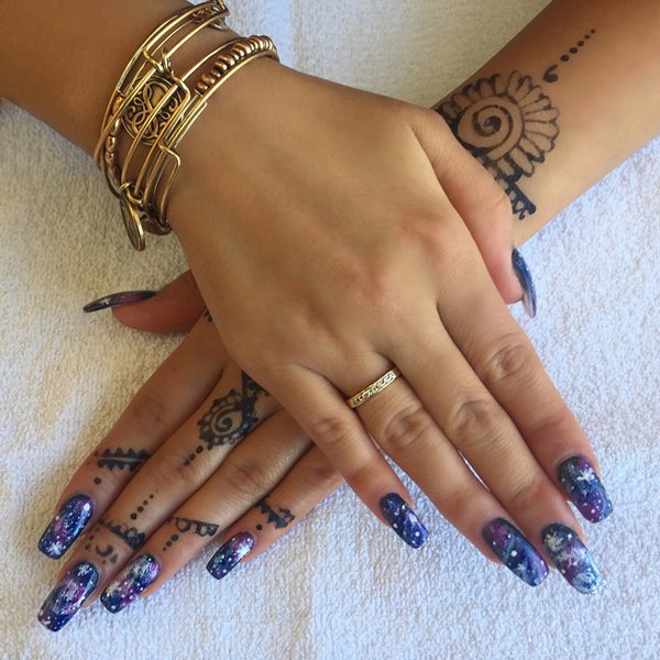 48 stunning galaxy nail designs video tutorial you can spruce up your galaxy nail design by adding hand art in ink or henna to your fingers to match the beautiful galaxy design of your nails solutioingenieria Images